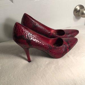 Red snakeskin heels gently worn